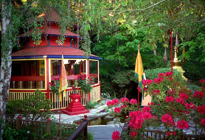 Photo of the prayer wheels in the meditation garden