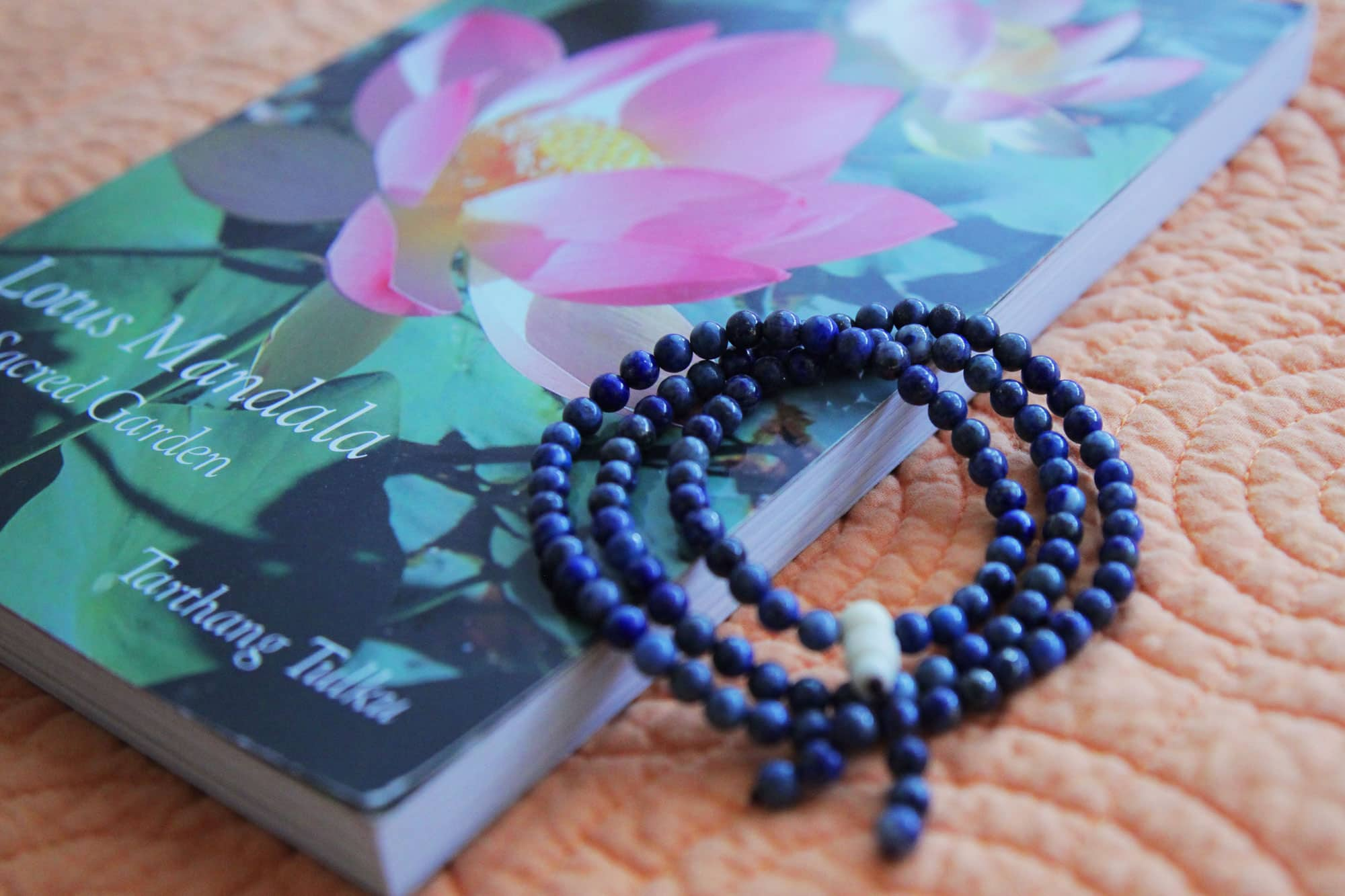 Image of prayer beads and a book, Lotus Mandala