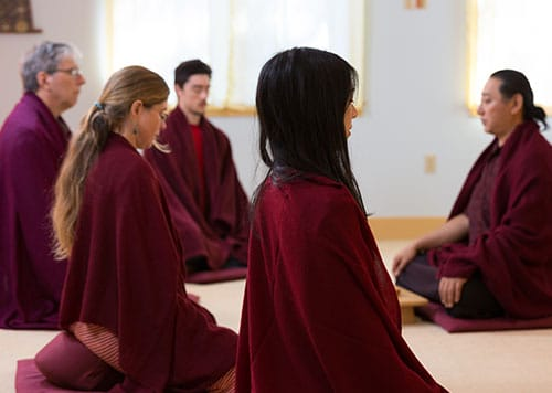 Image of students and teacher in Meditation