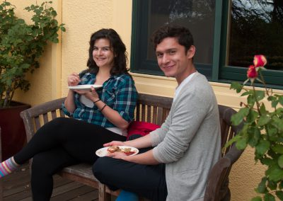 Imageof two students sitting outside