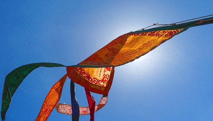 Image of Prayer Flags covering the sun